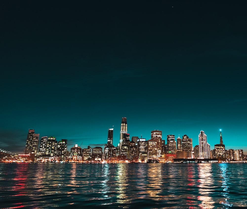 skyline photo of sea and buildings