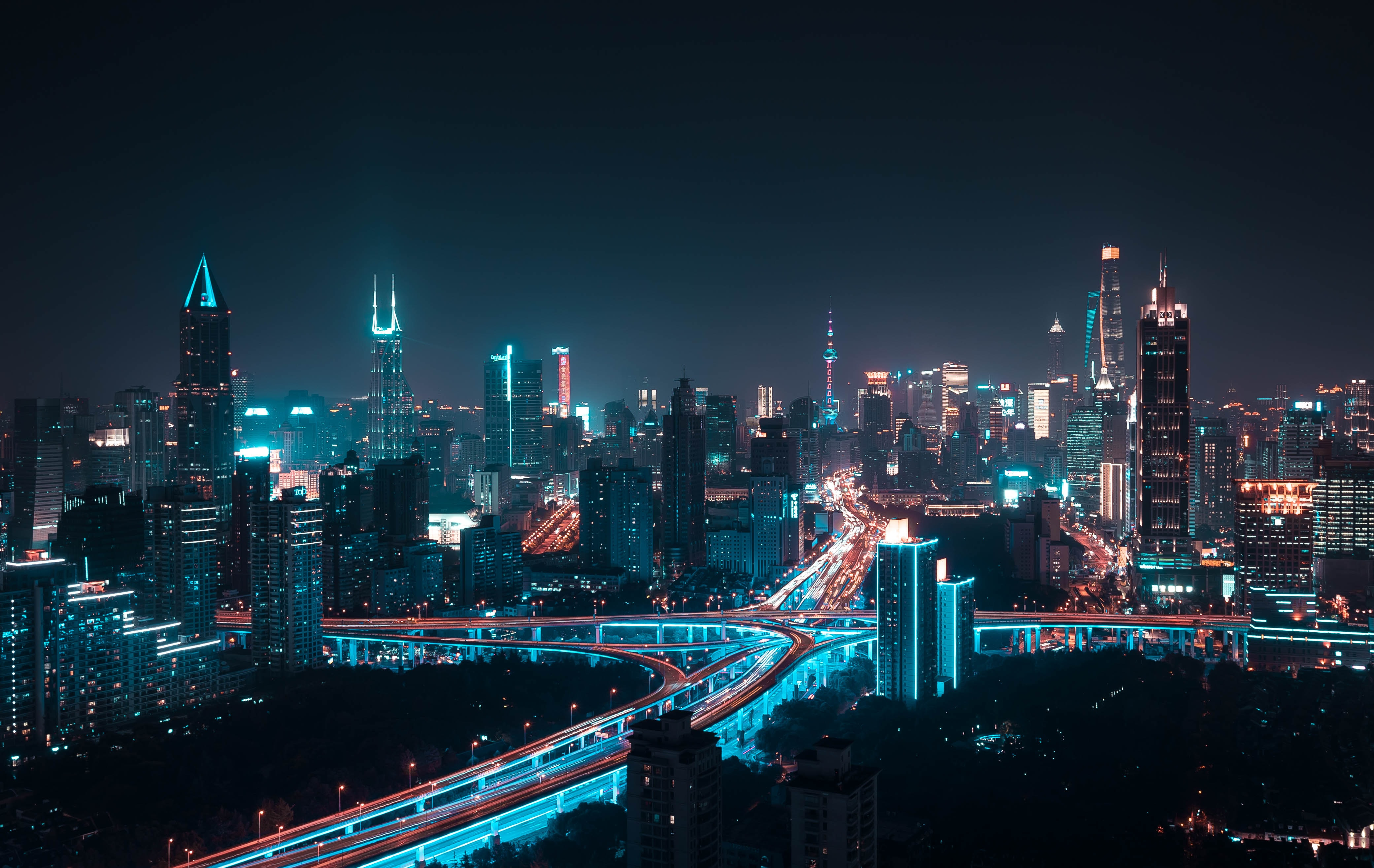 aerial photography of lightened city buildings at night time