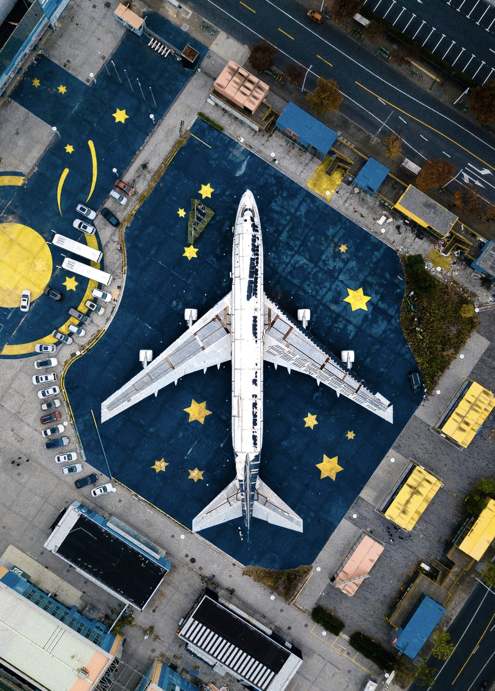 aerial photography of white and black air liner on airport during daytime