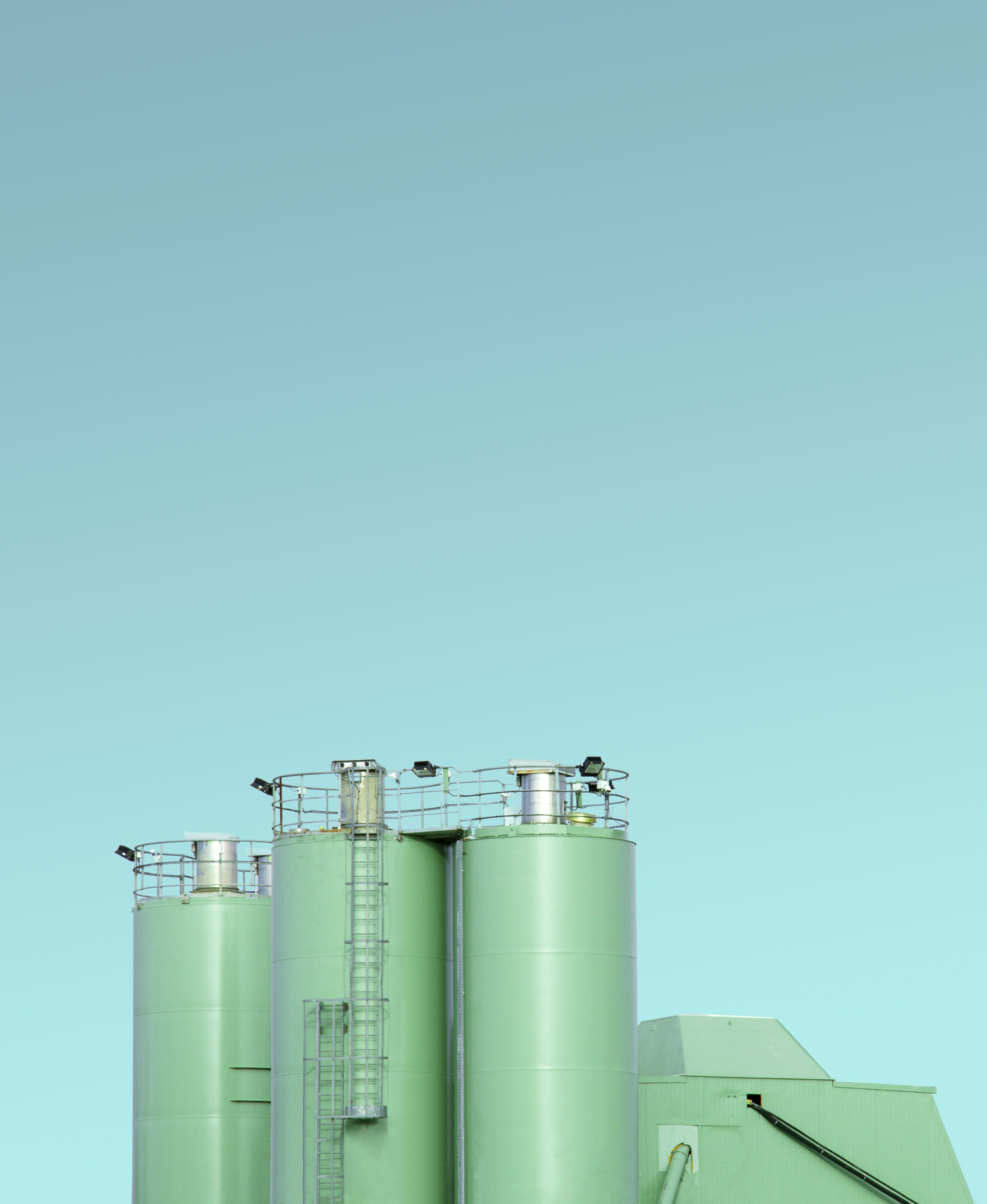 photo of teal and grey silo