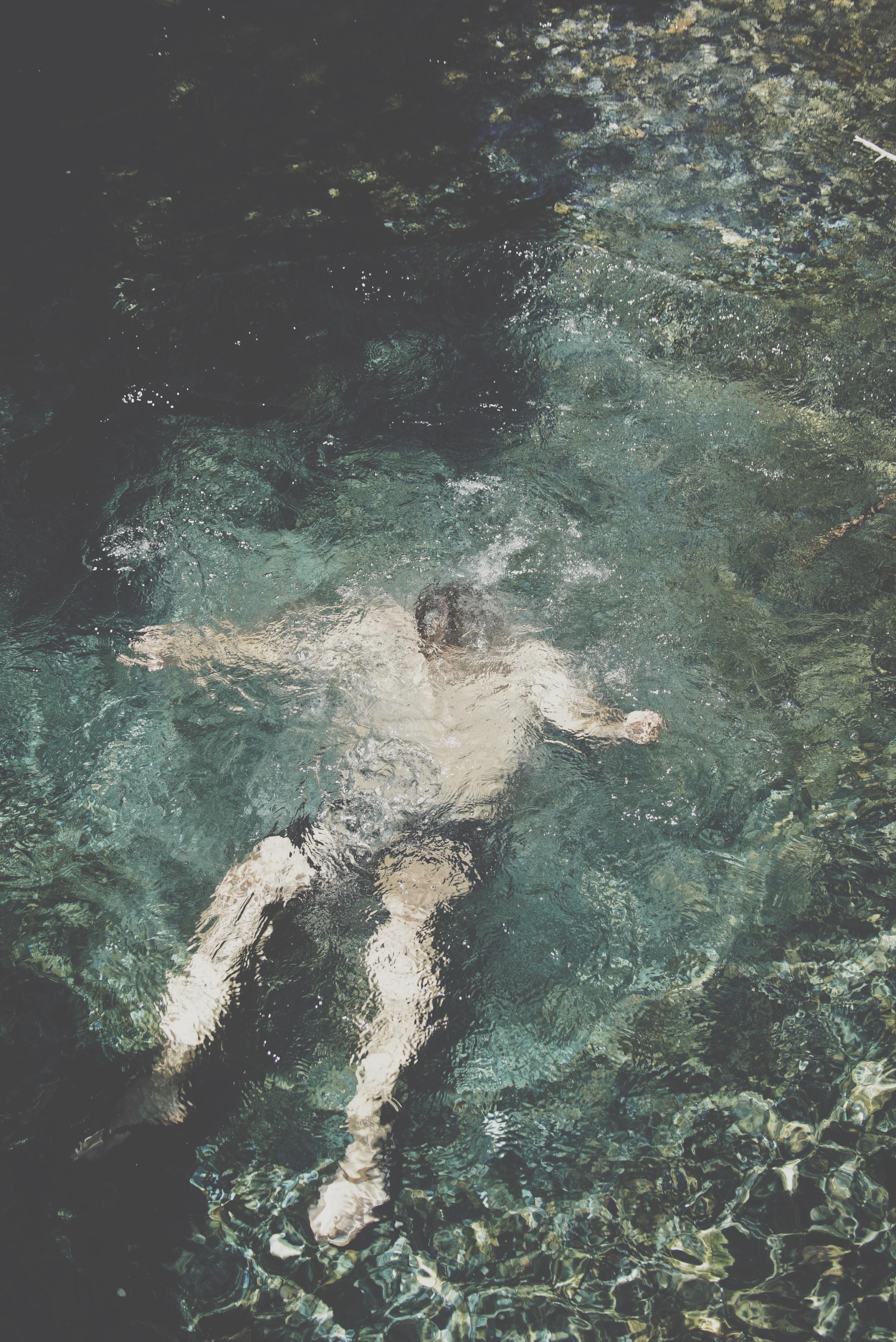 person submerged underwater