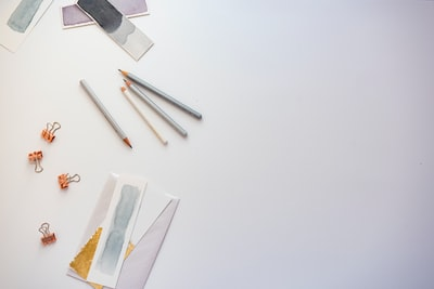 high angle photo of four pencils and greeting card lay zoom background