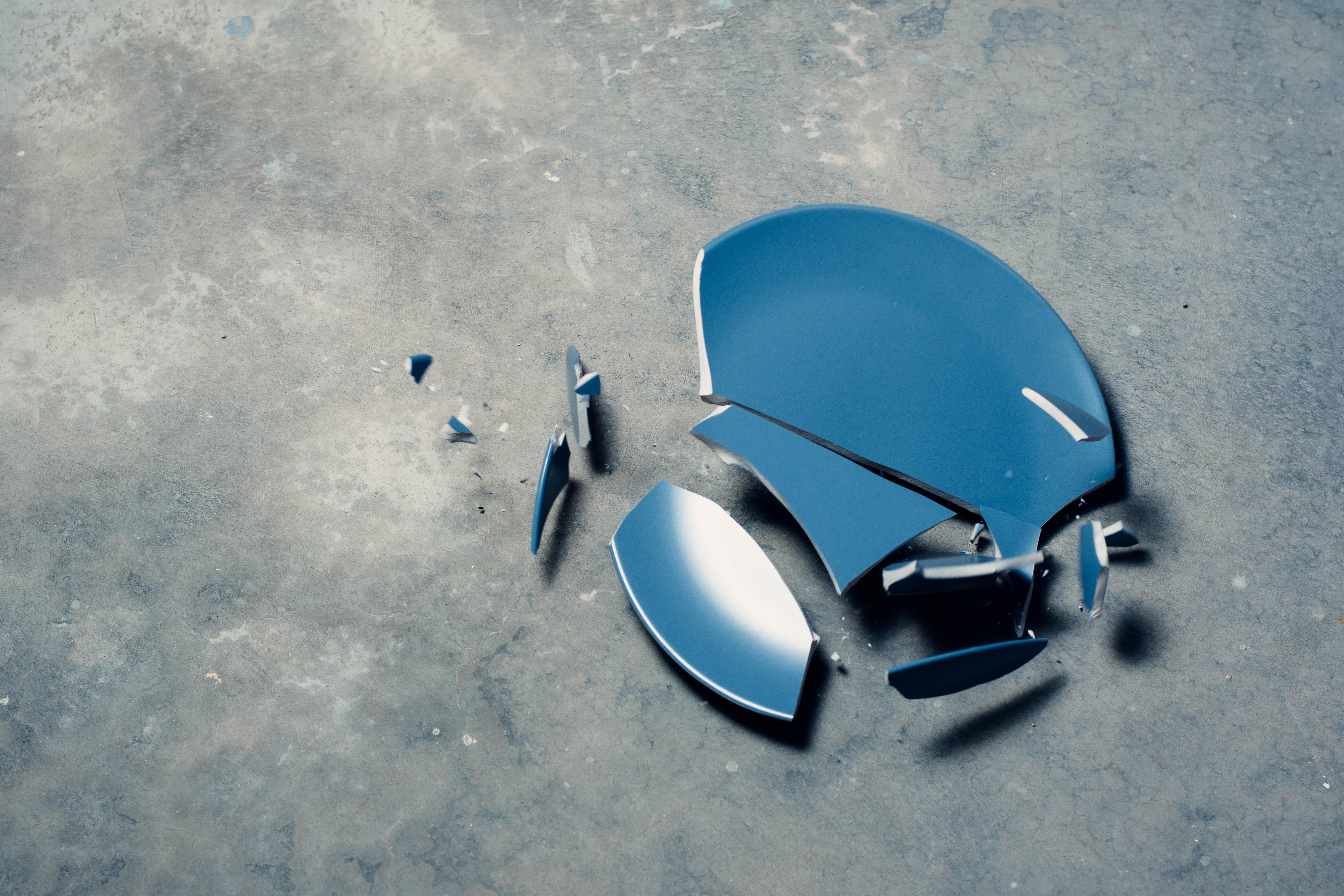 broken blue ceramic plate