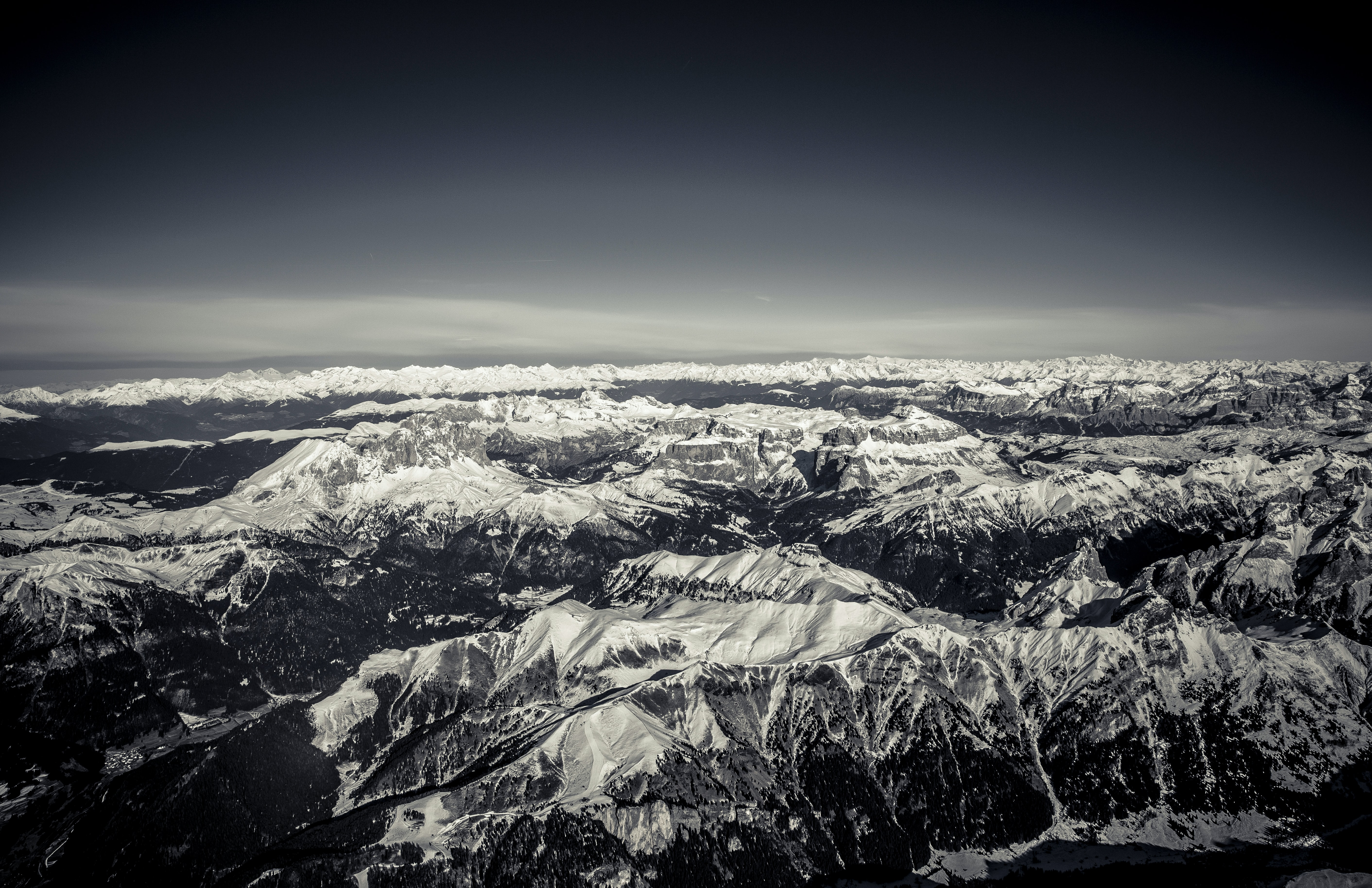 aerial and grayscale photography of glacier mountains