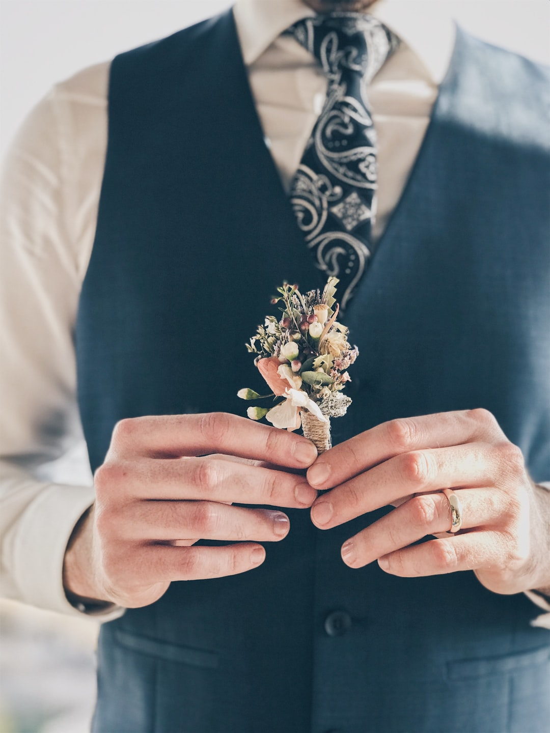 groom with a flower