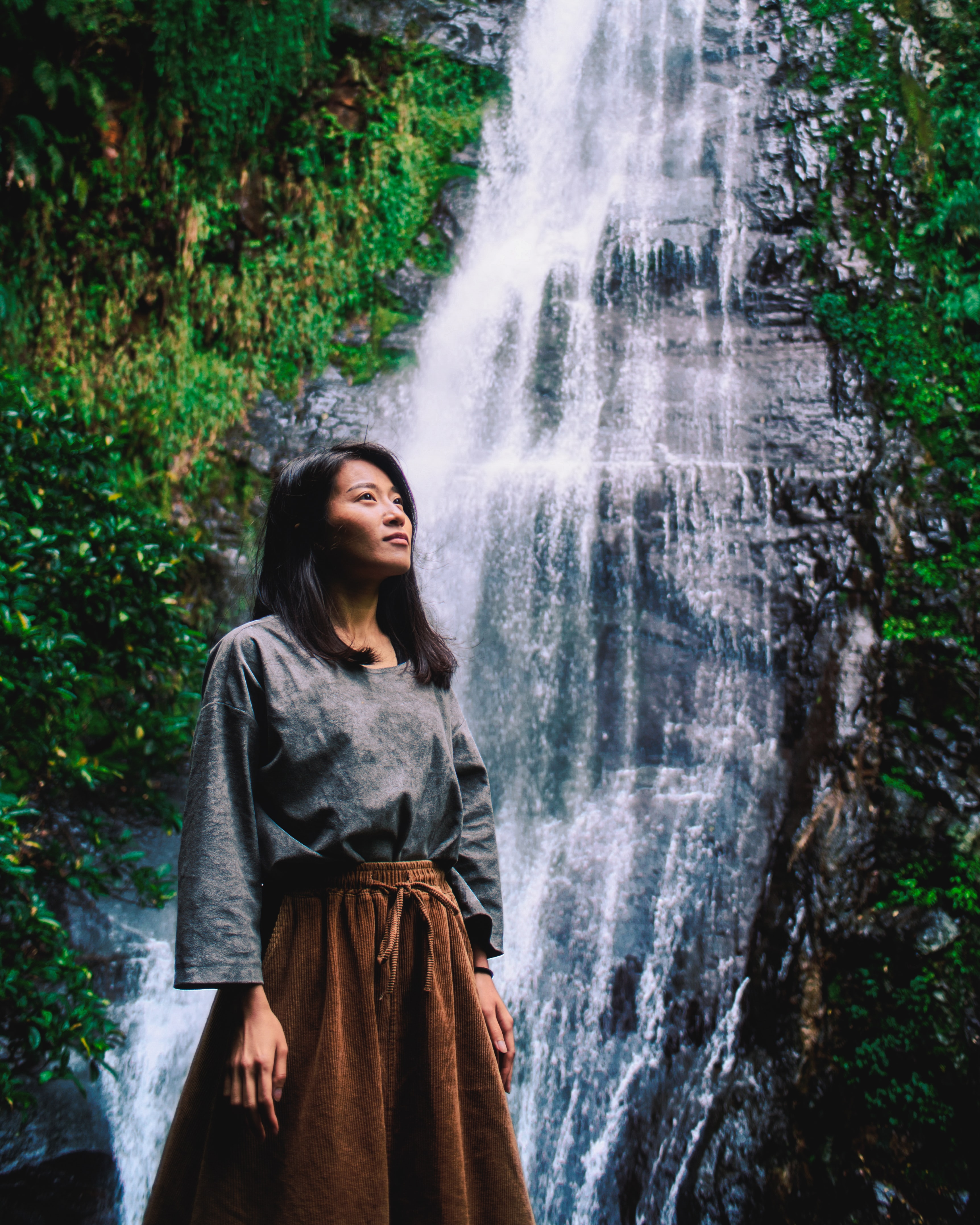 woman posing near the waterfalls