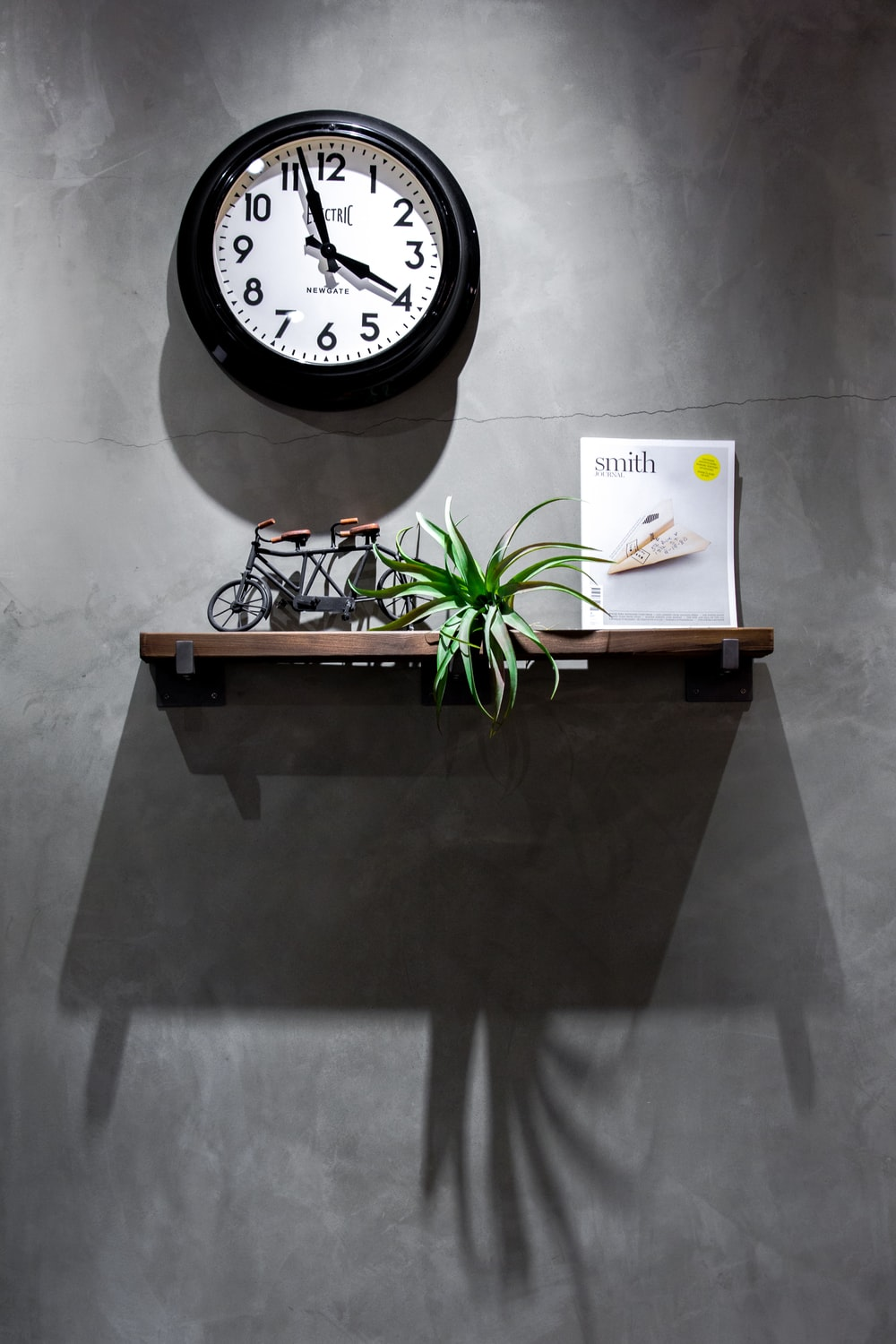 black and white analog wall clock displaying 3:58