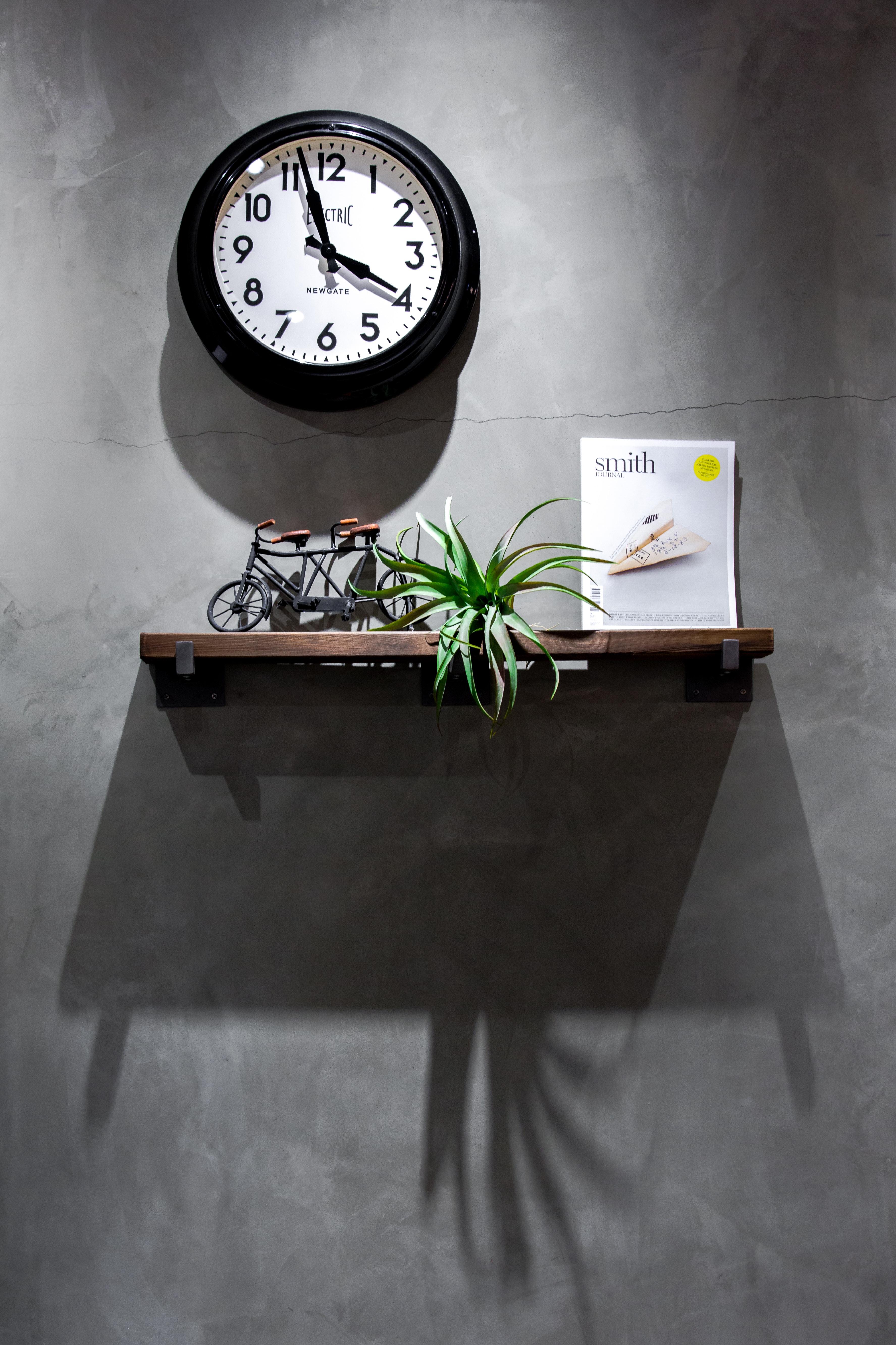 black and white analog wall clock displaying 3:58