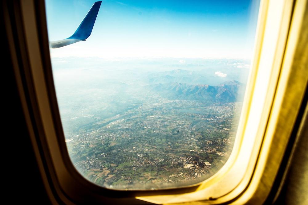 beige plane window view