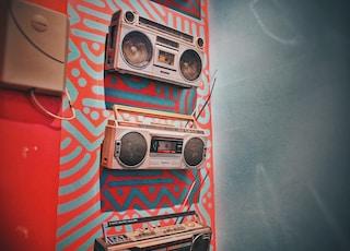 three gray boombox hanging on wall