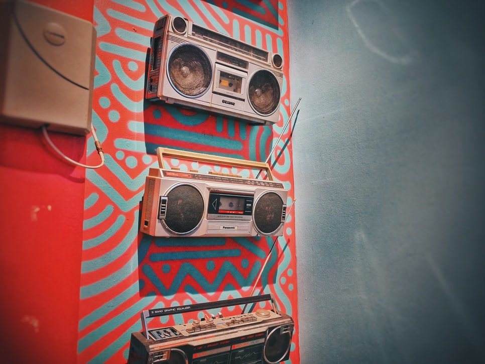 three gray boombox hanging on wall