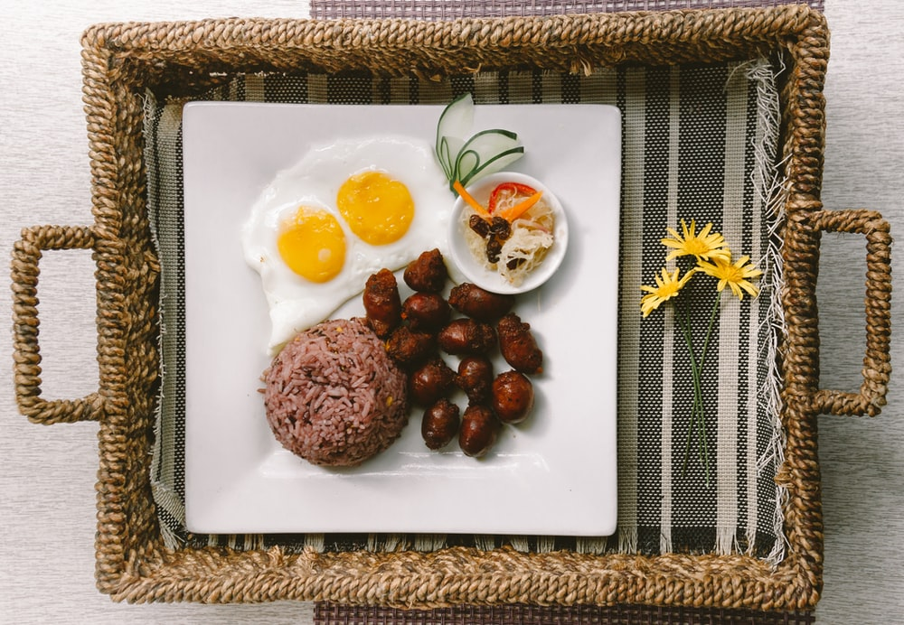 plate of foods on brown wicker tray