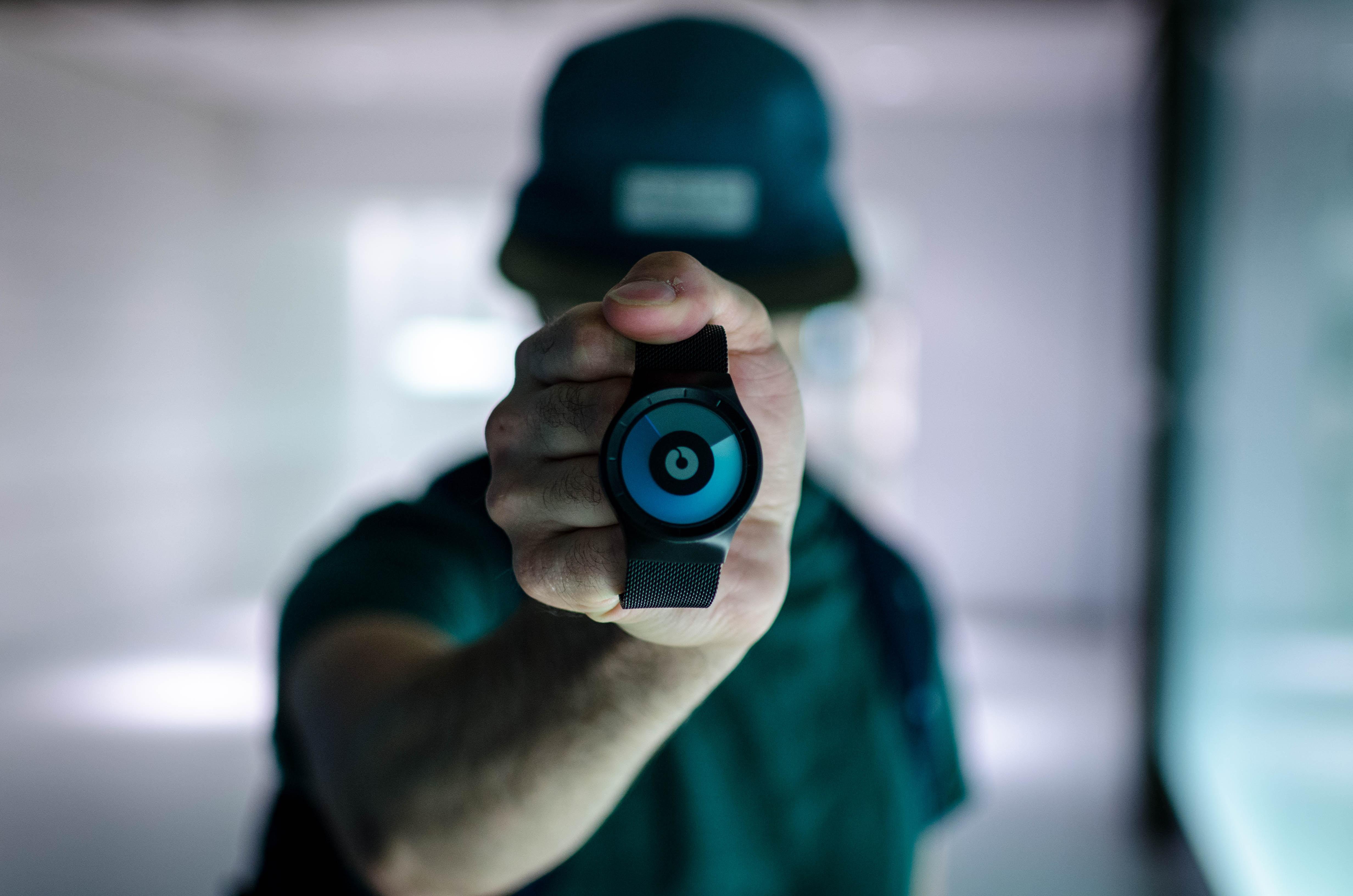 man holding black Ziiiro watch