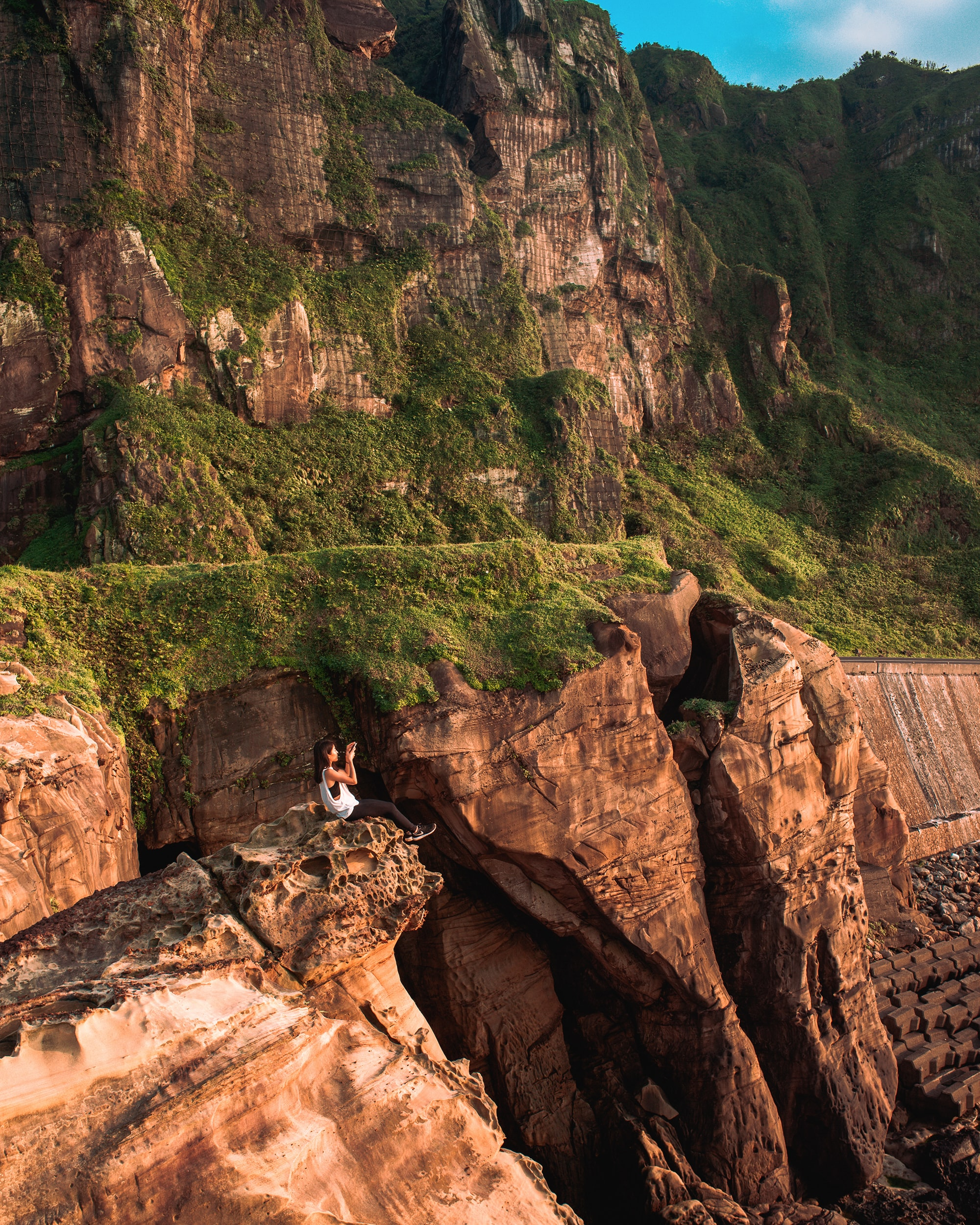 woman on rock formation cliff
