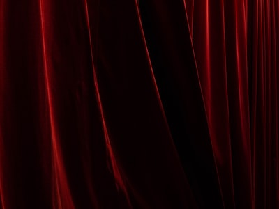 red textile curtain teams background