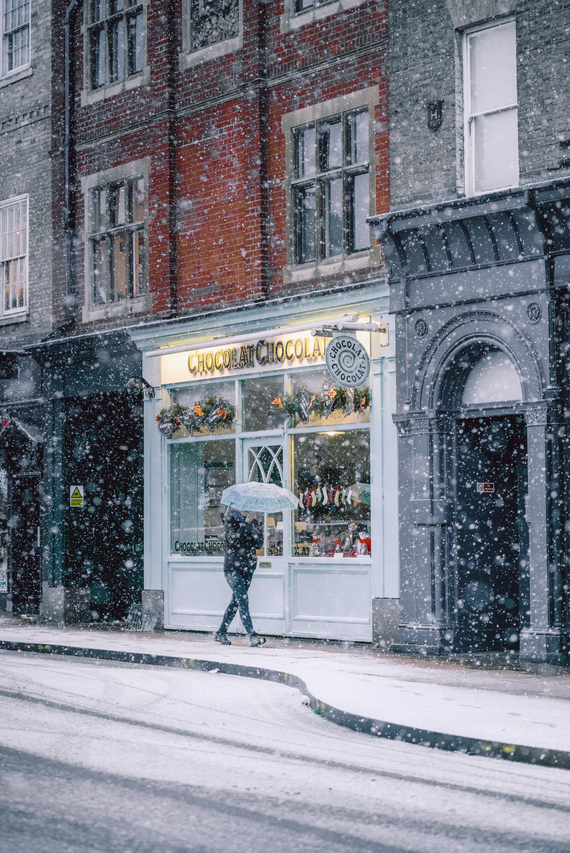 parson walking near cafe during winter