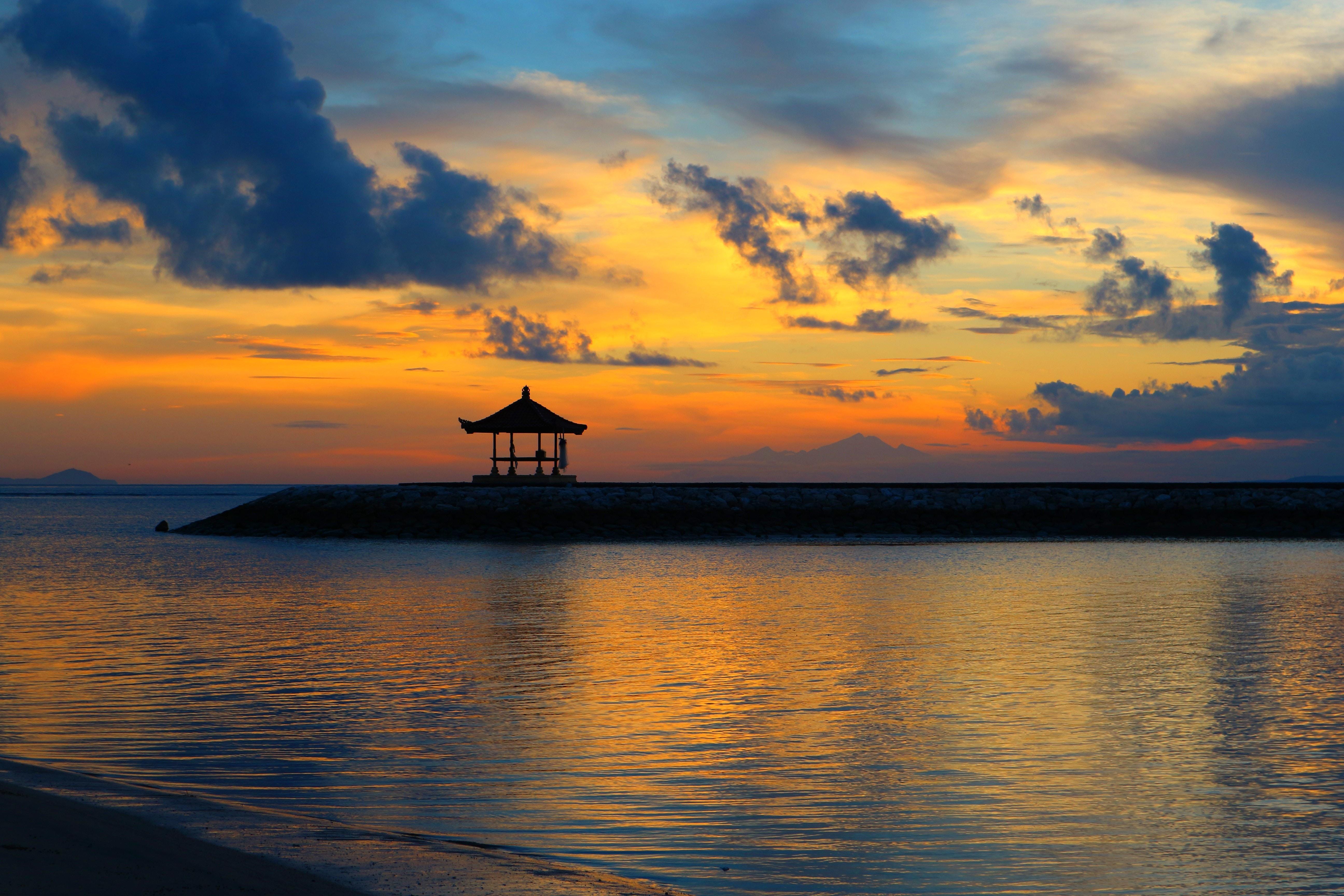 silhouette of gazebo during daytime