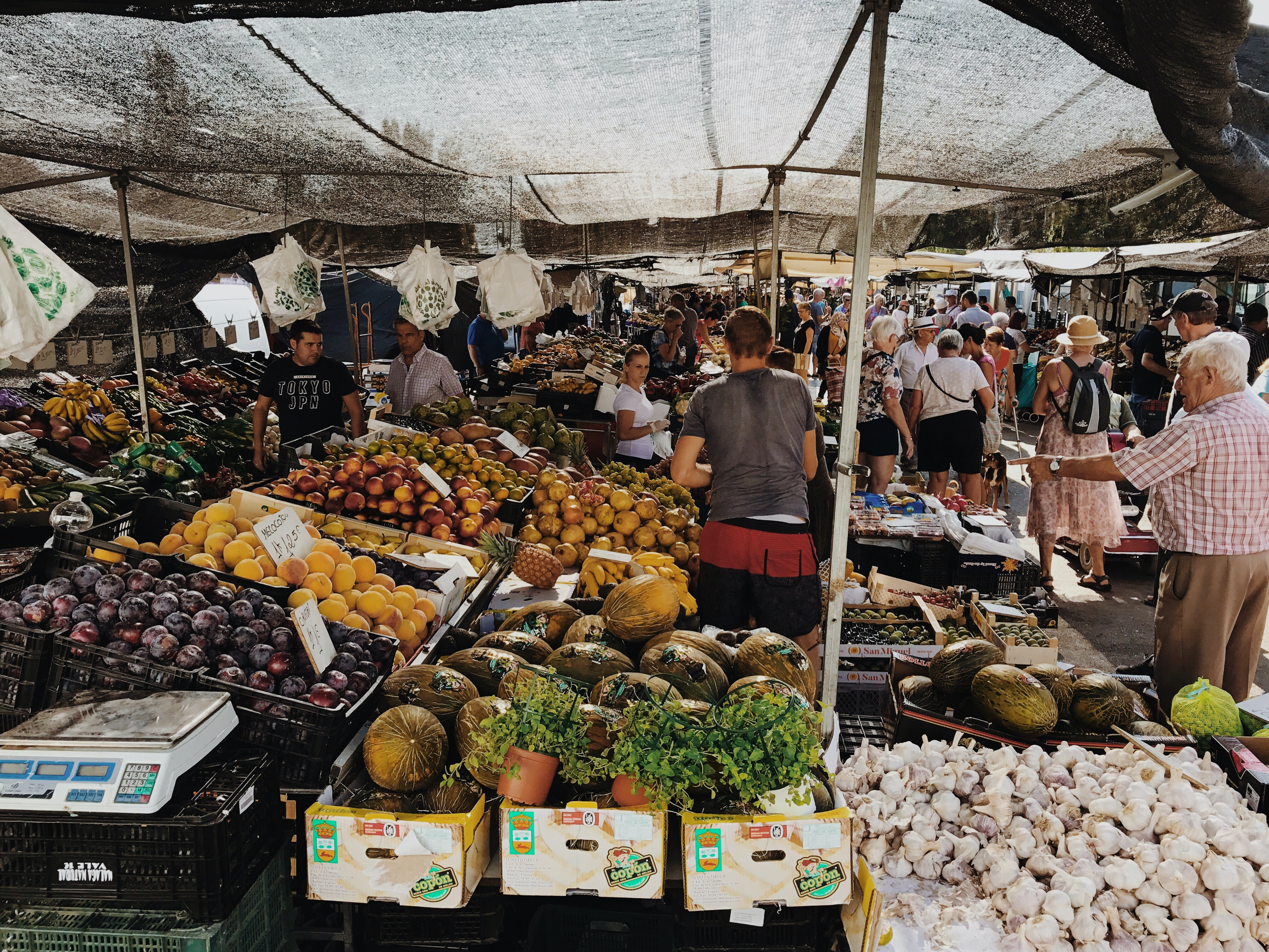 group of people at the vegetable market