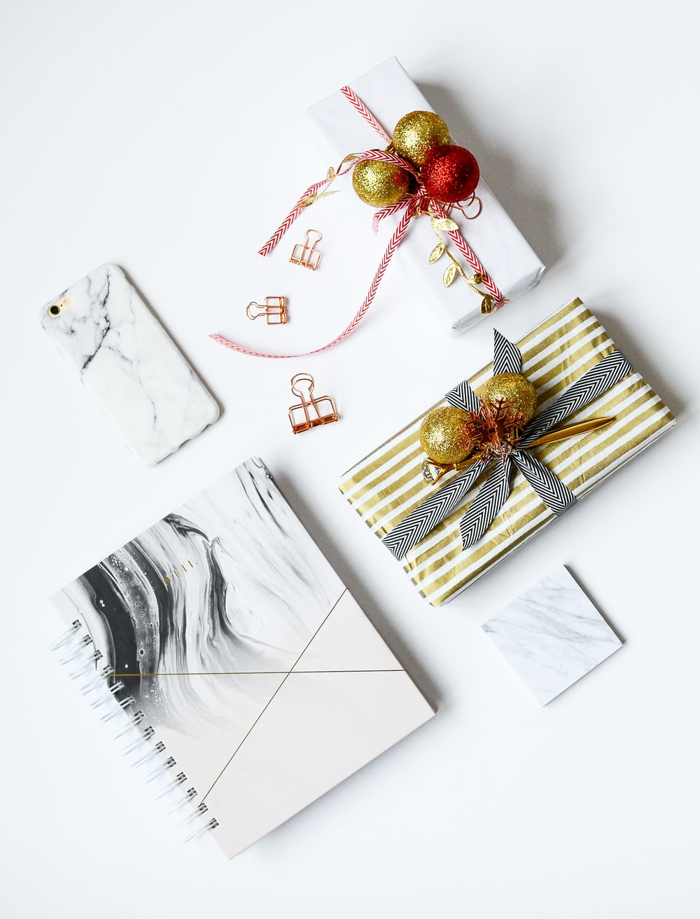 several assorted-color present boxes and notebook on table