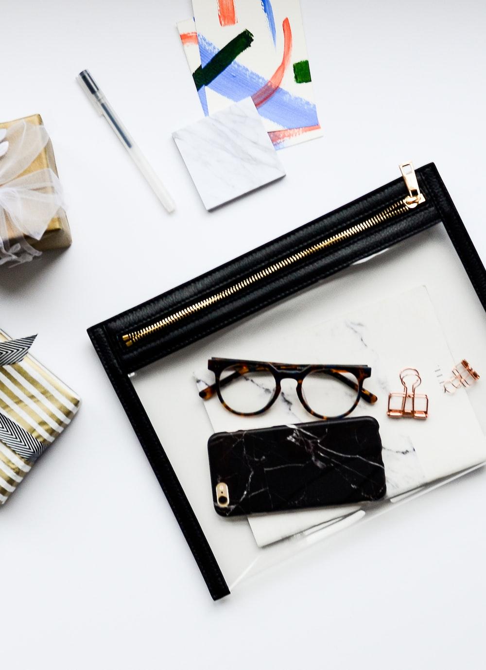 black framed eyeglasses inside clear plastic pouch