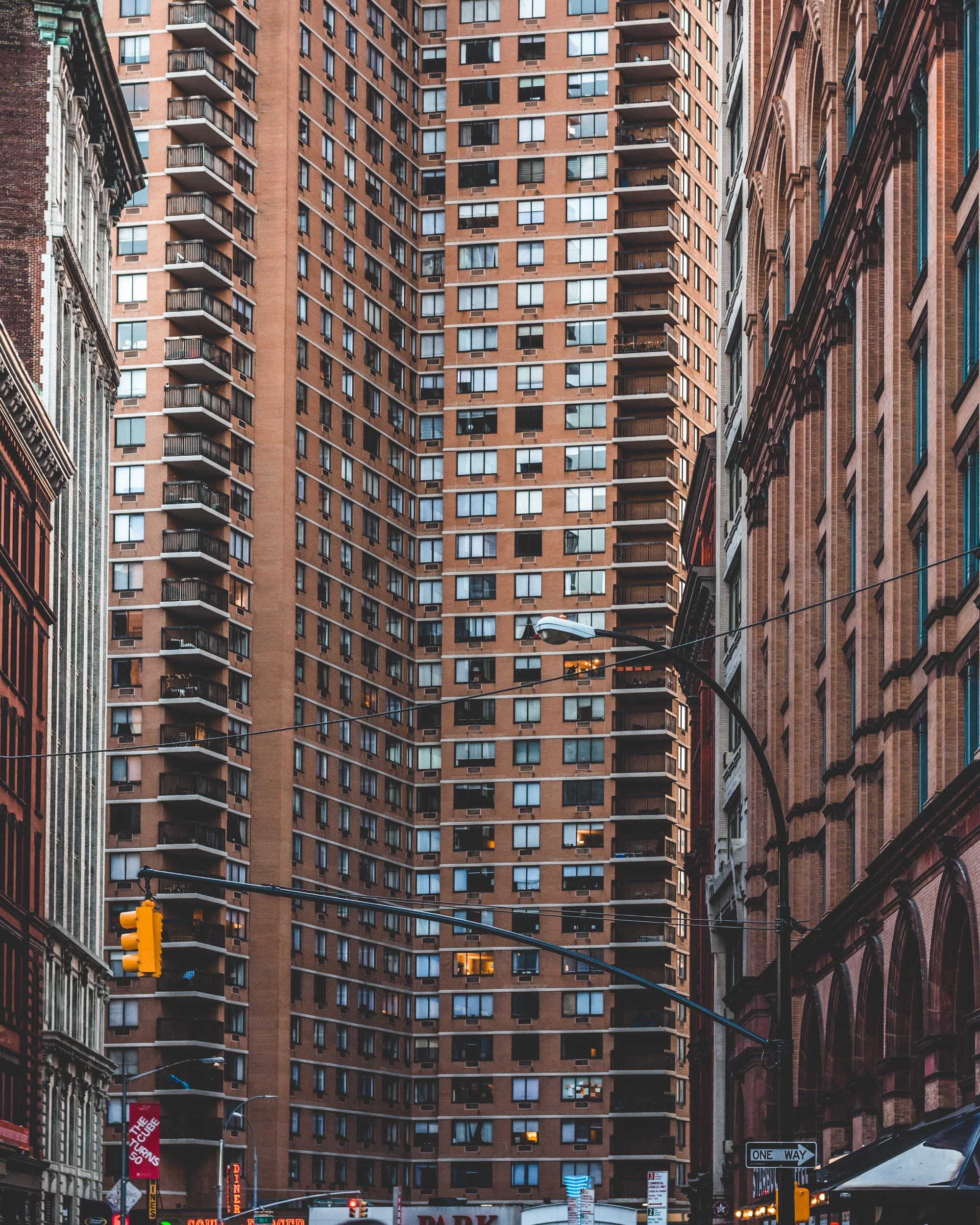 brown high rise building low angle photography
