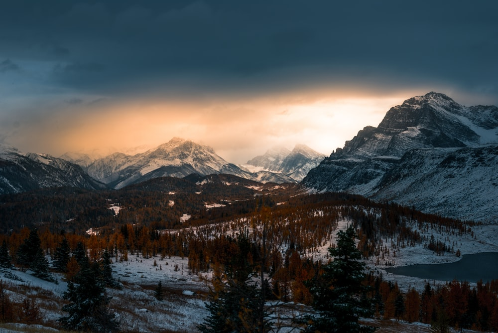 landscape photo of mountain covered with snow under cloudy sky