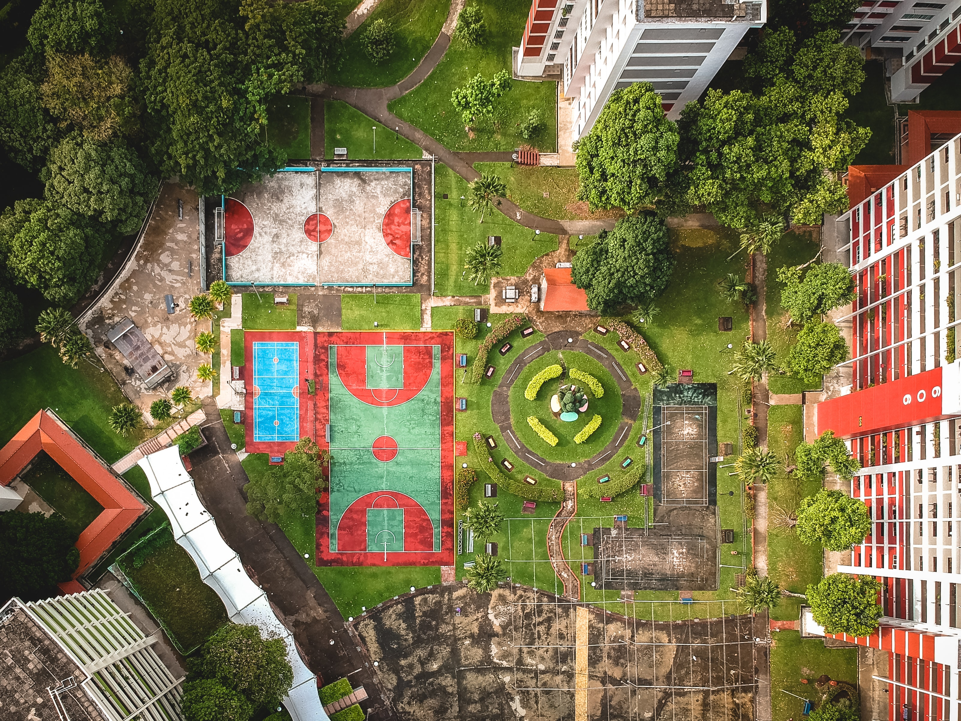 top-view photography of two basketball court beside concrete building at daytime