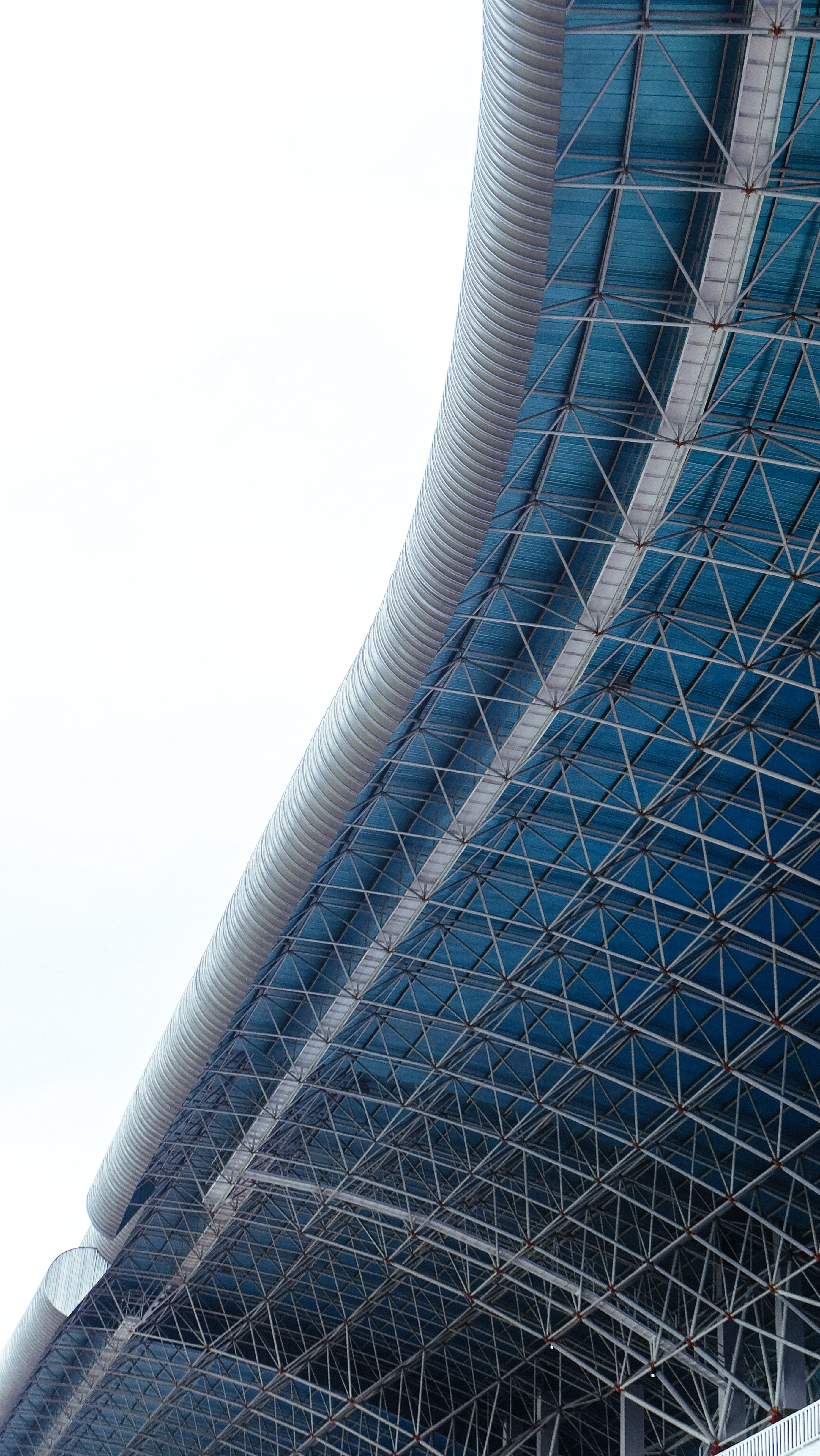 architectural photo of gray and blue metal building