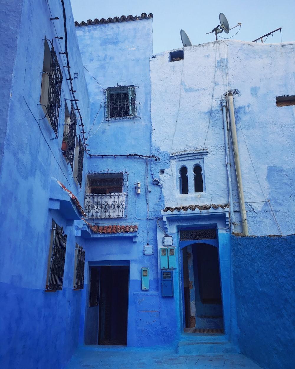 blue and gray concrete 3-storey building