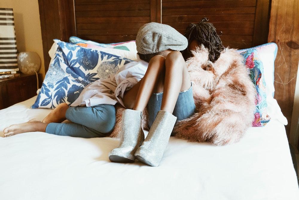 woman lying on white mattress