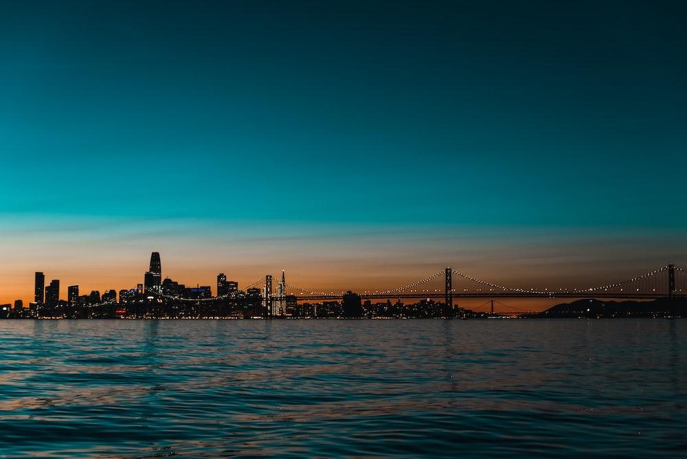 suspension bridge photo during dawn