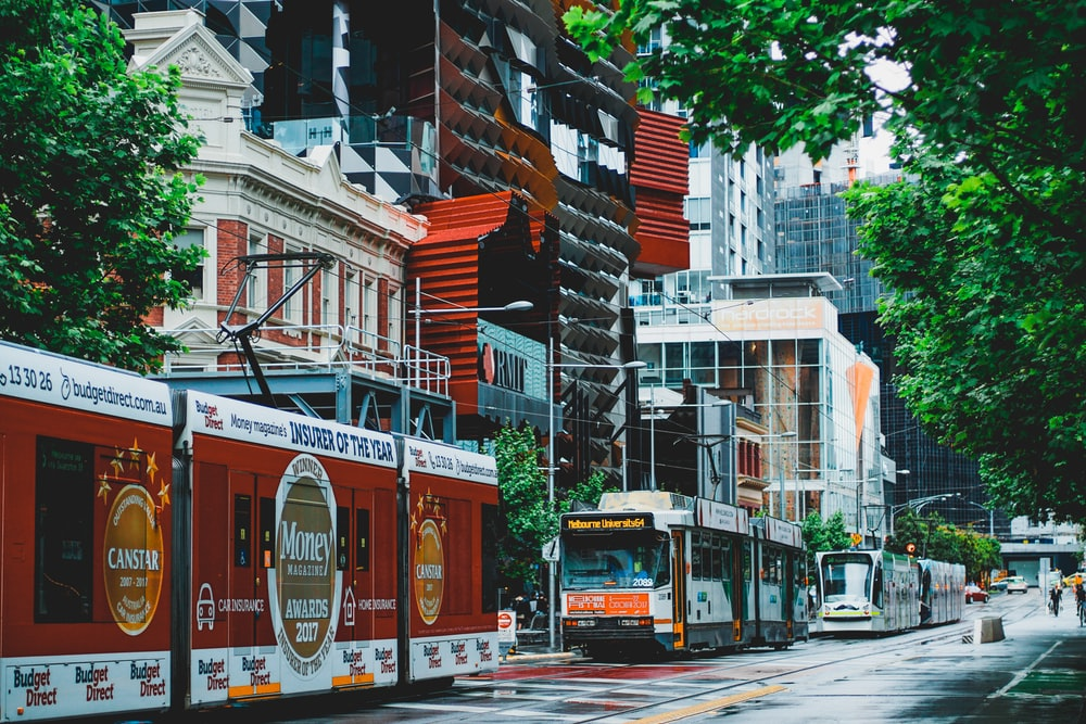 tram on road near buildings