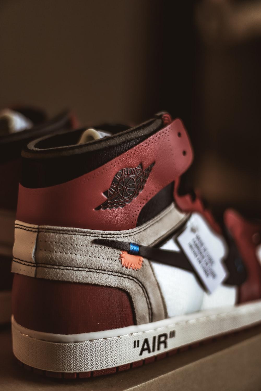 pair of red-and-white Air Jordan 1's