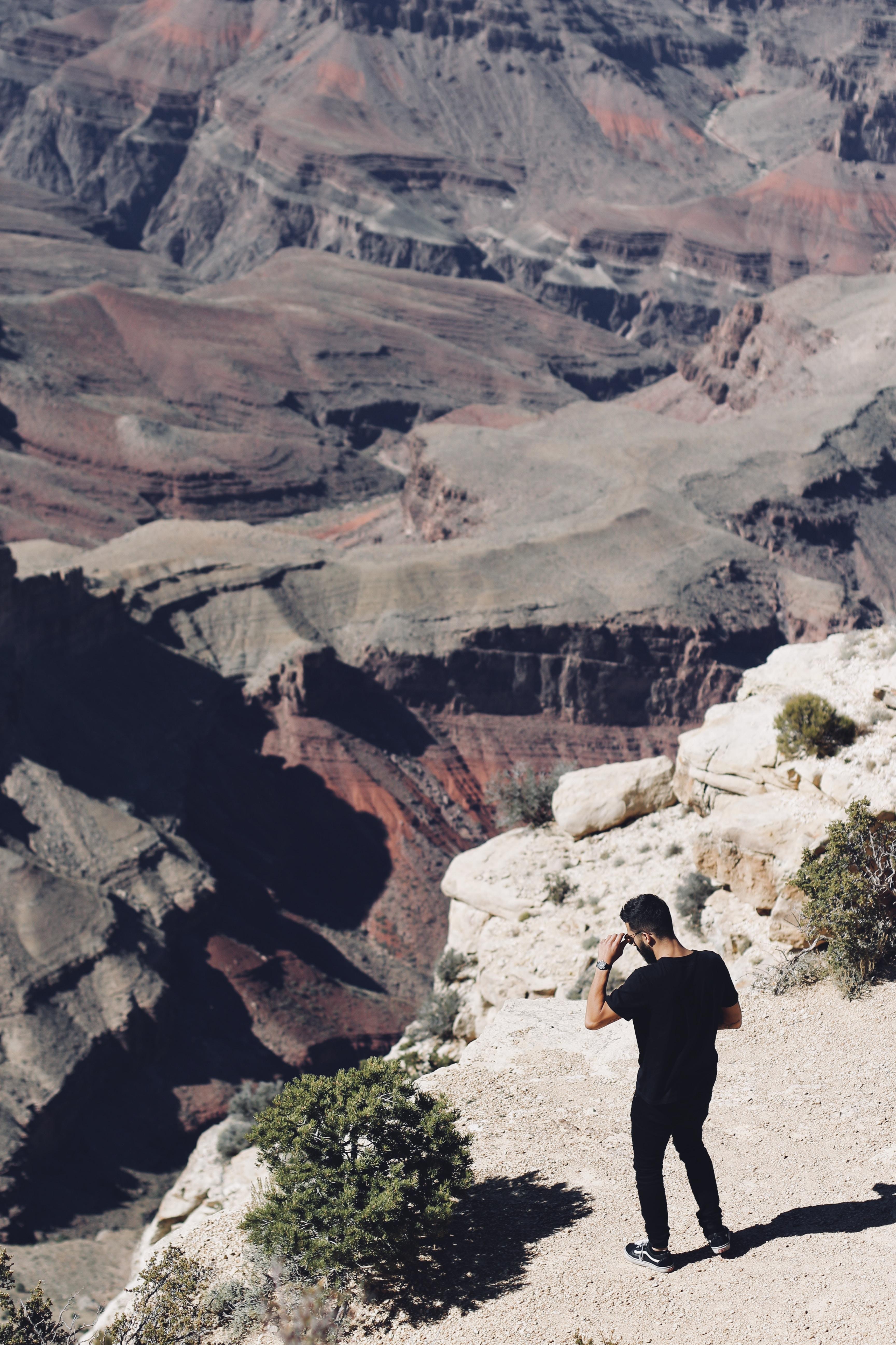 man standing on mountain rocks