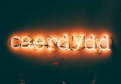 yellow caerdydd neon signage turned on luminescence zoom background
