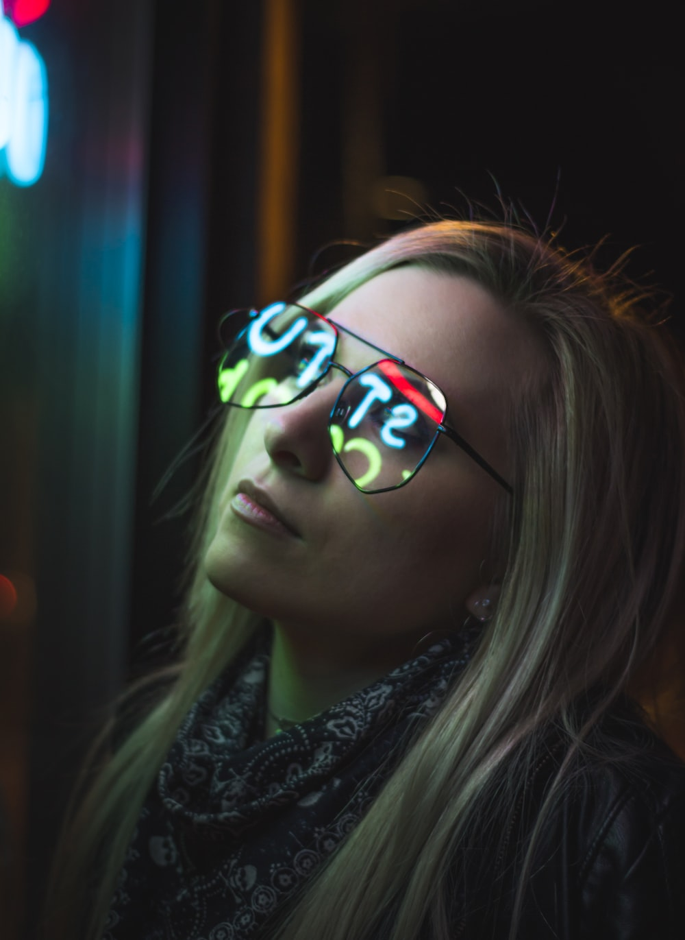 selective focus photo of woman staring at LED sign