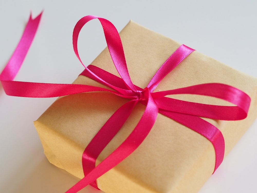 brown gift box with pink ribbon
