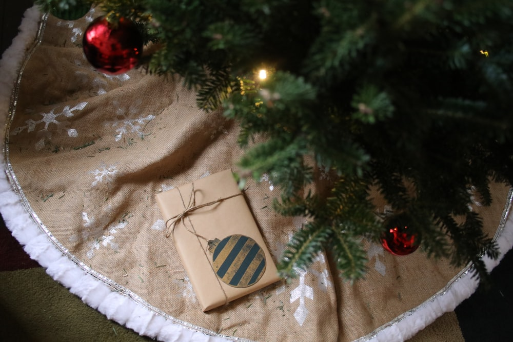gray wrapped gift below the Christmas tree