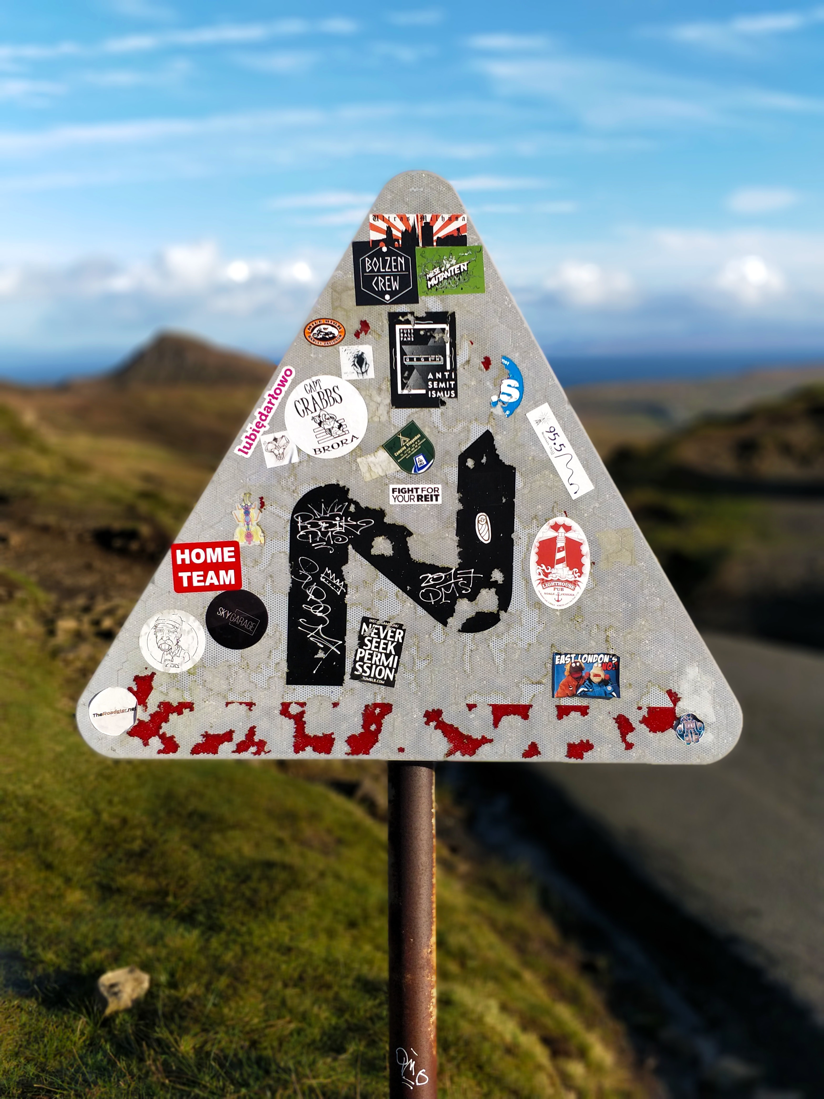 stickers on road signage