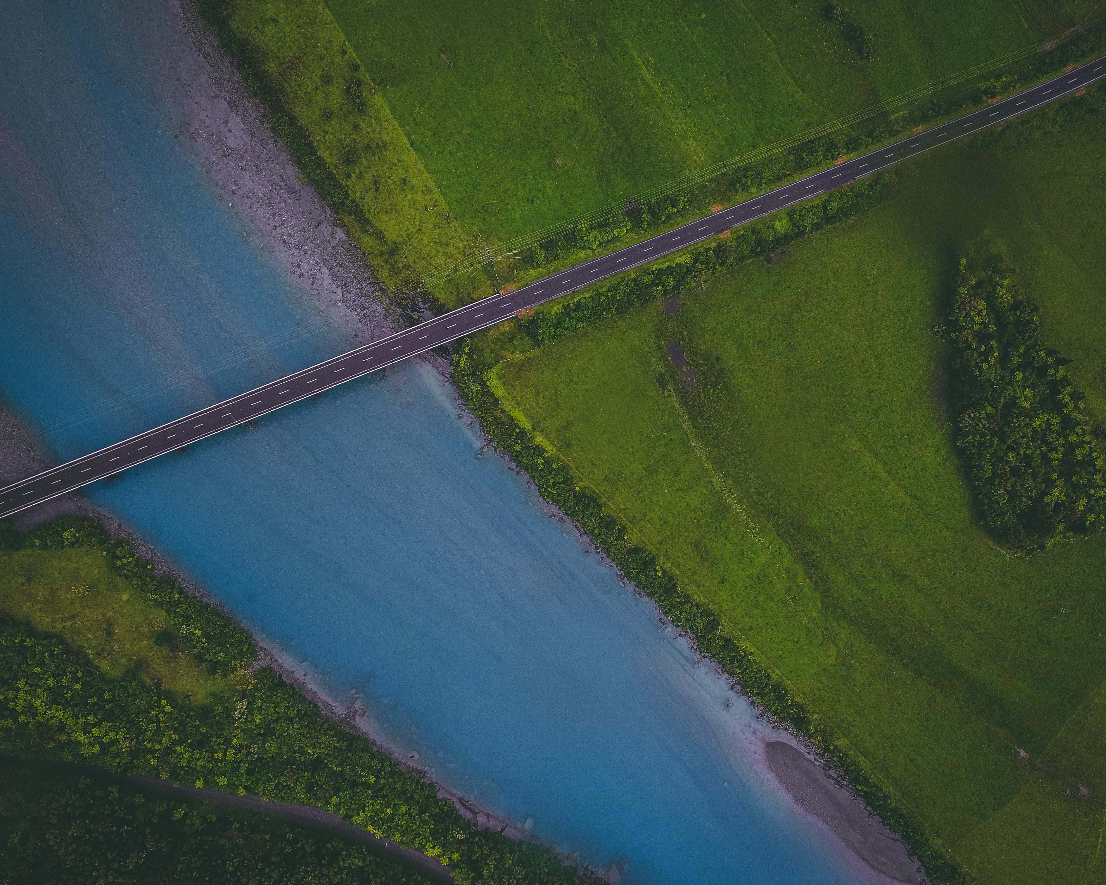 aerial photography of bridge near green grass field
