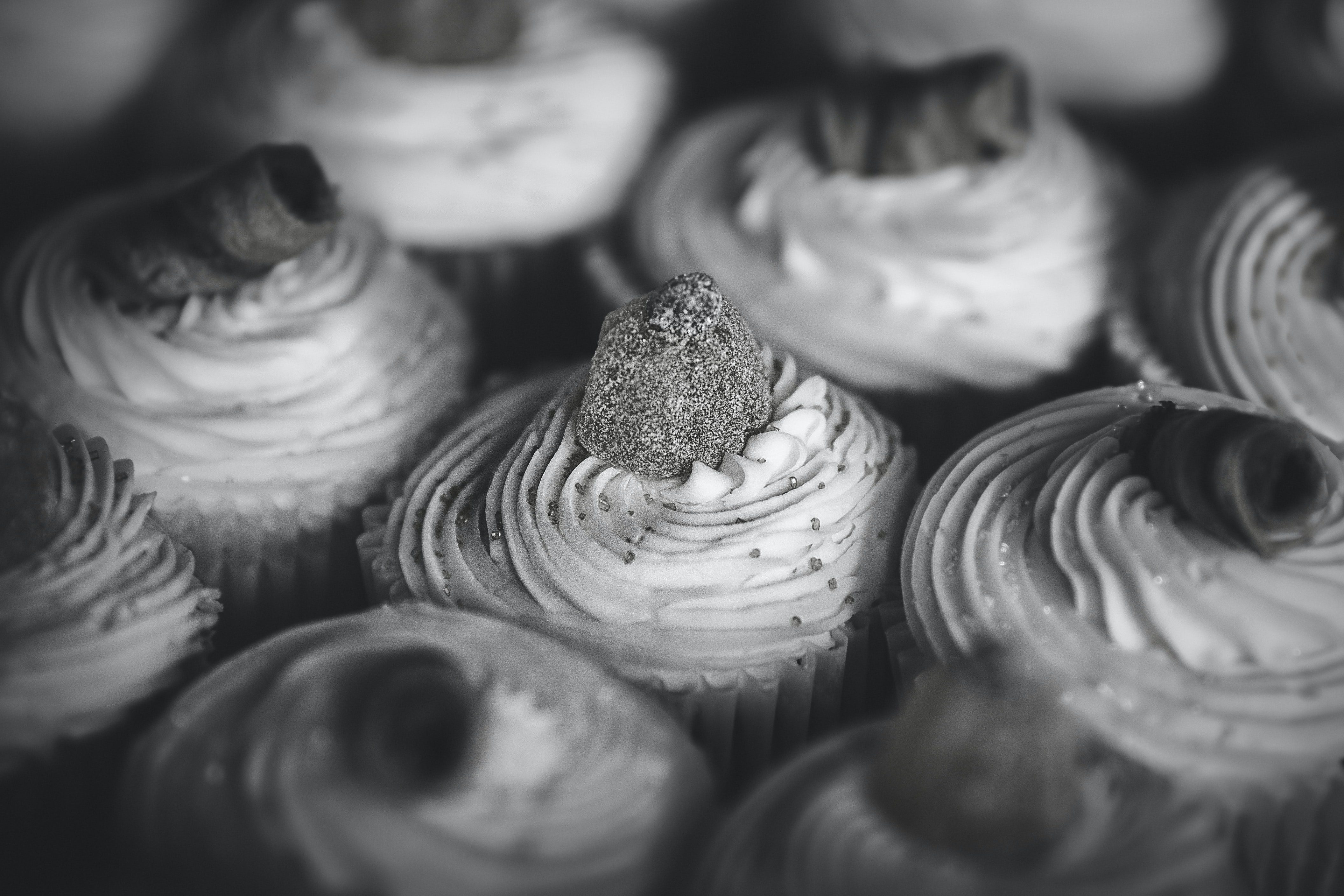 grayscale photo of cupcakes