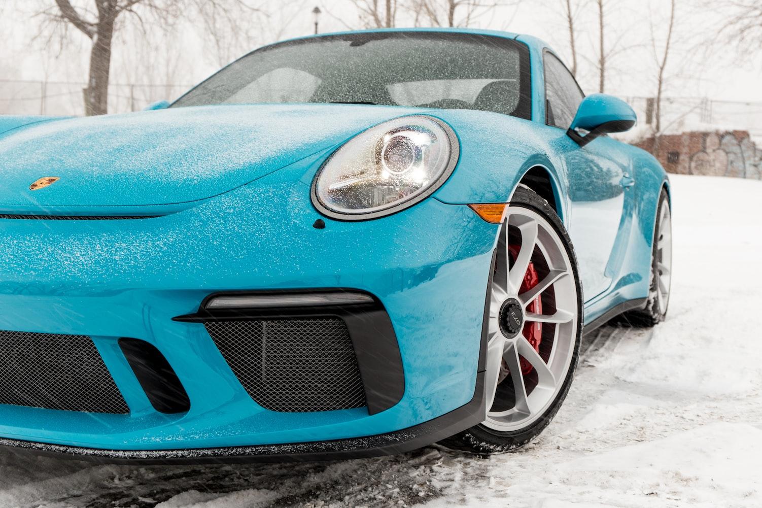 Blue Porsche Cayman in snow