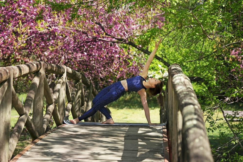 woman on bridge doing exercise