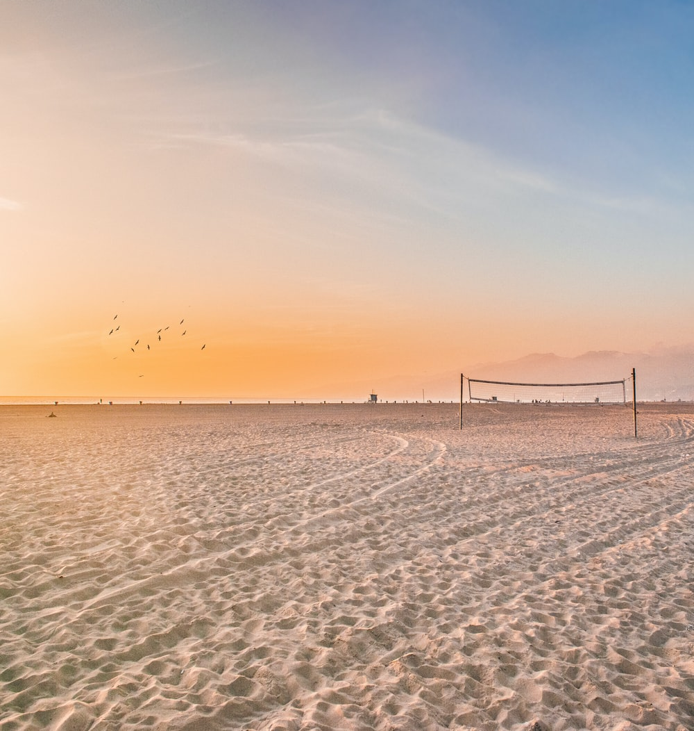 photo of volleyball net on sands