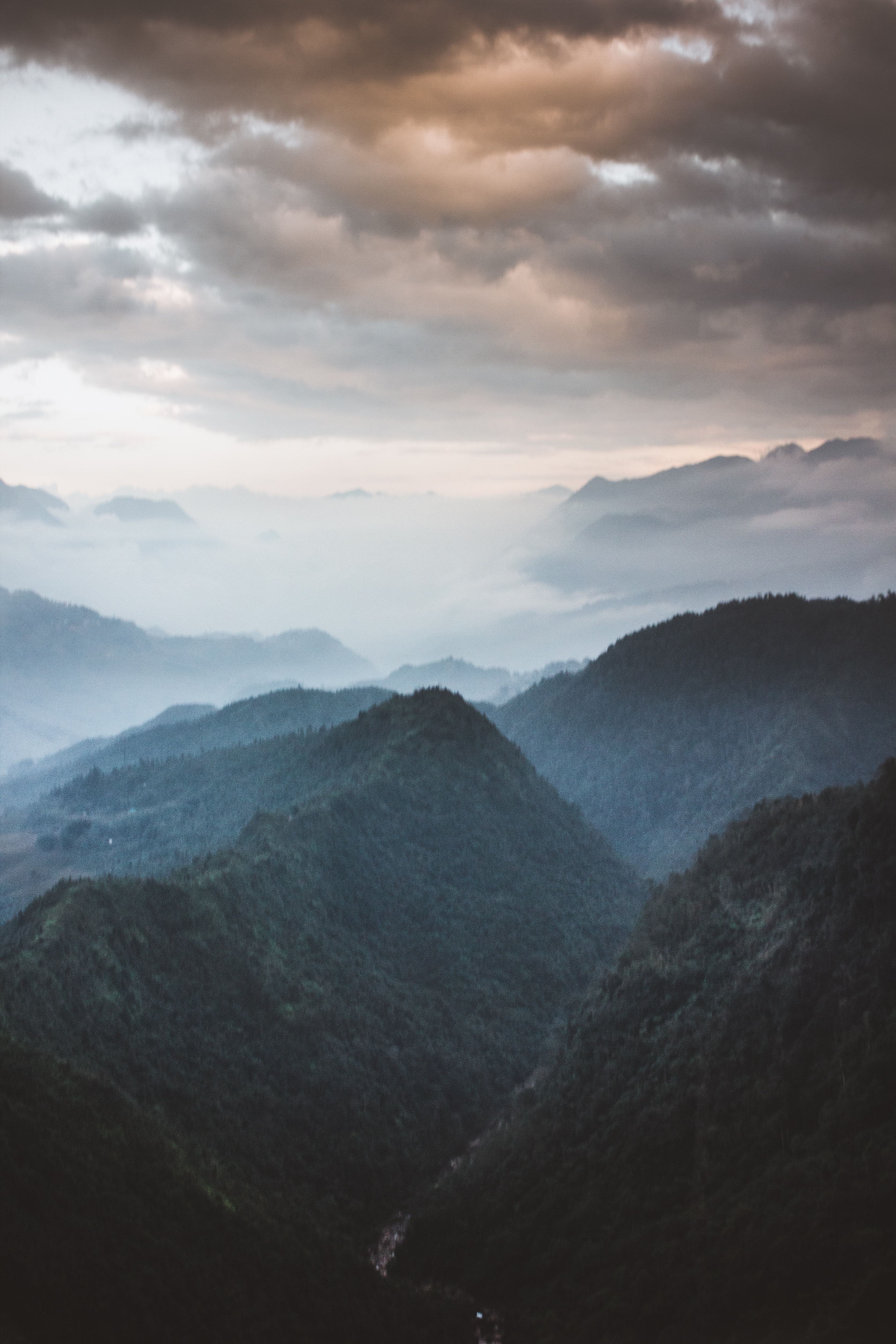 bird's-eye view photography of mountain valley with clouds