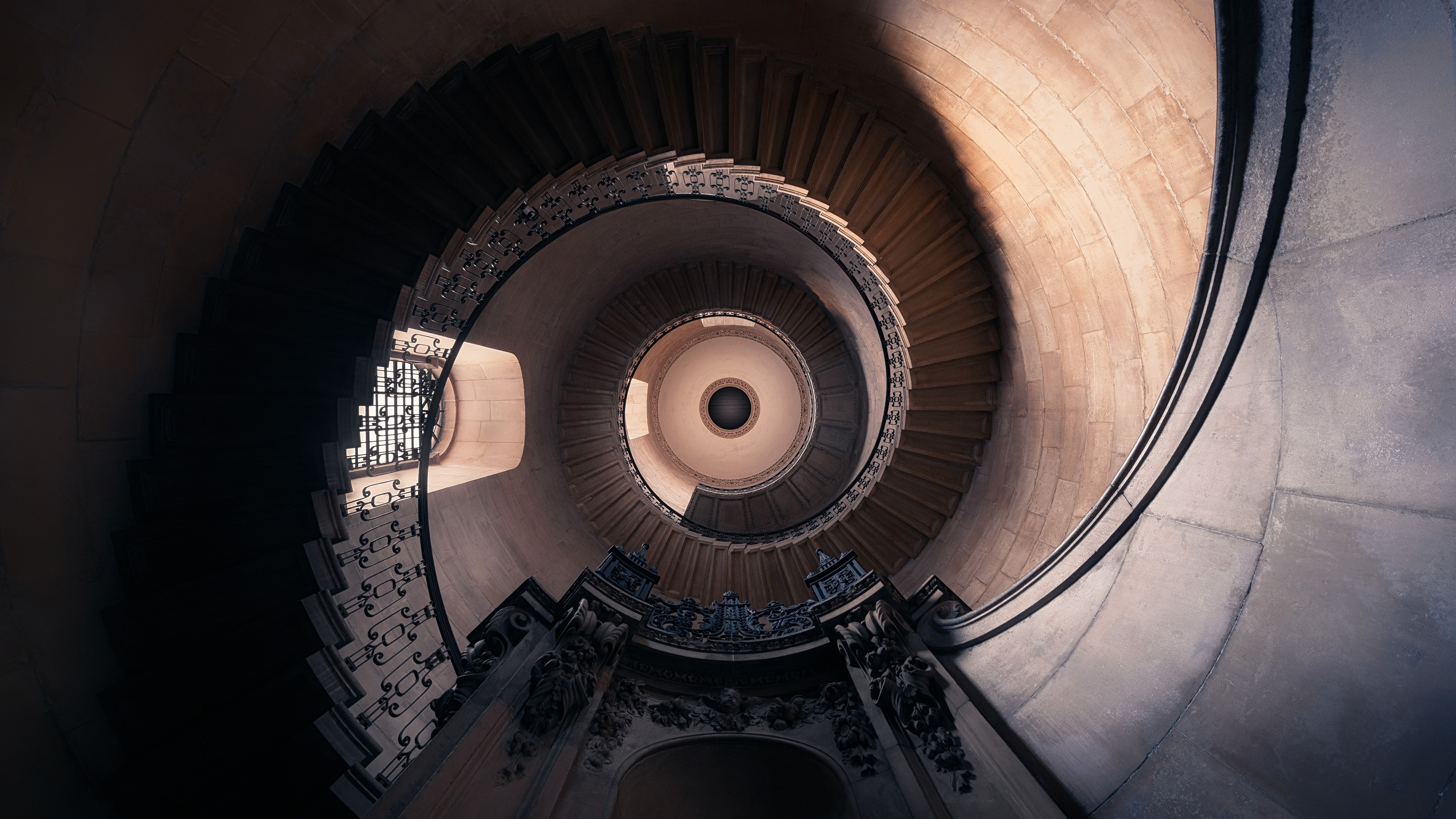 low angle photo of spiral stairs
