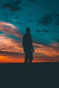 silhouette on man standing on ground