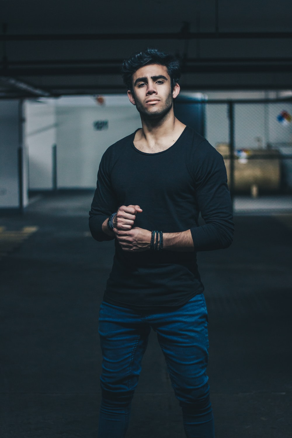 man wearing black crew-neck long-sleeved t-shirt