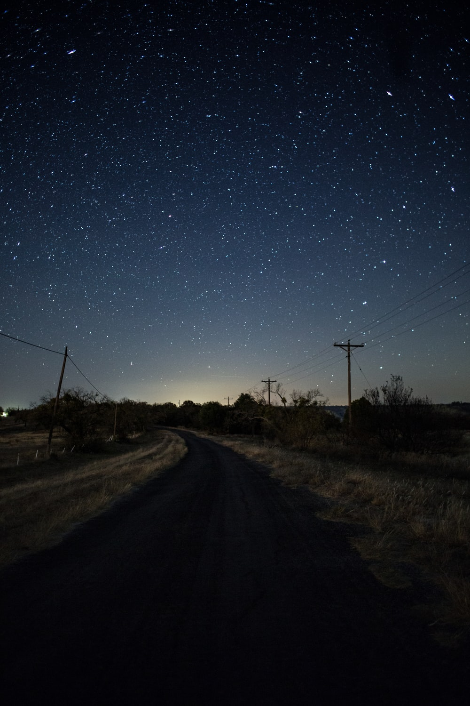 empty road under starry nights