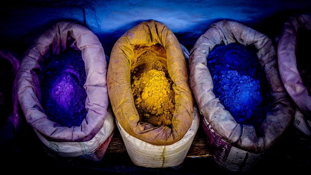 three assorted-color powder sacks